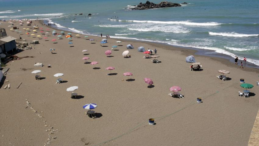Mediterranean Beach Tourism: Pay for your free umbrella or get stabbed!