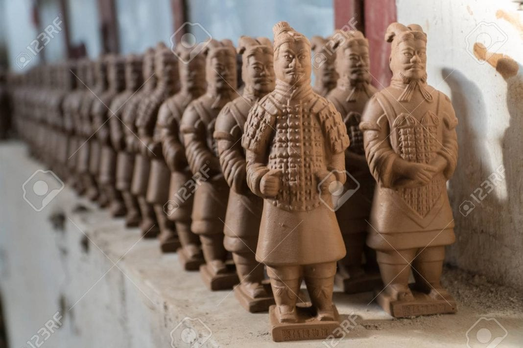 91728049-terracotta-warrior-replicas-on-shelf-drying-in-factory-in-xian-china