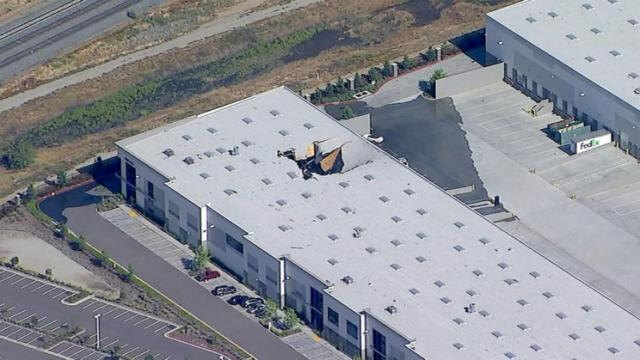 F-16 fighter jet crashes into warehouse east of Los Angeles