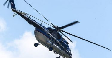 Pilot killed when helicopter hits power line, crashes into river in Russia