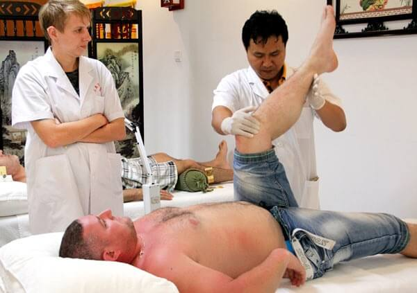 Russian tourists flock to China's 'Eastern Hawaii' for acupuncture and massage