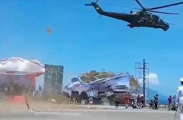 Russian  attack helicopter destroys VIP stands at Indonesian military parade