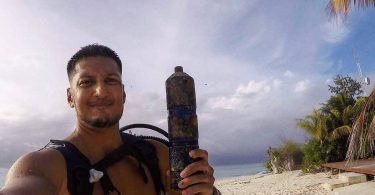 Ameer Holding One Of The Acoustic Recievers That He Had Just Retrieved From A Dive