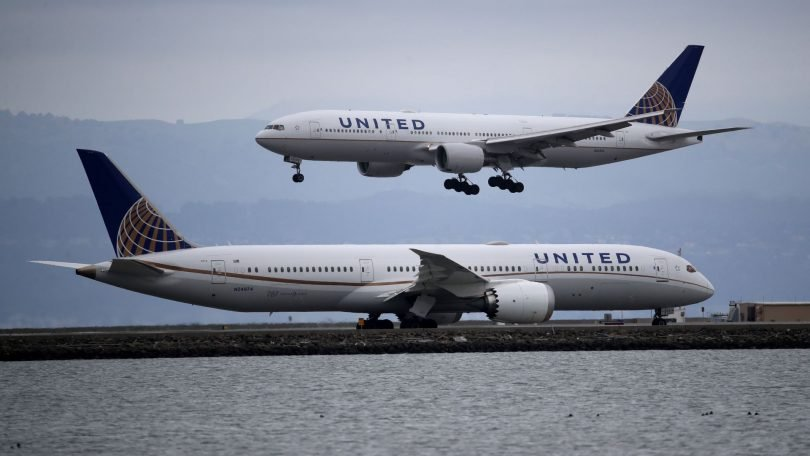 United Airlines scales back domestic and international schedules