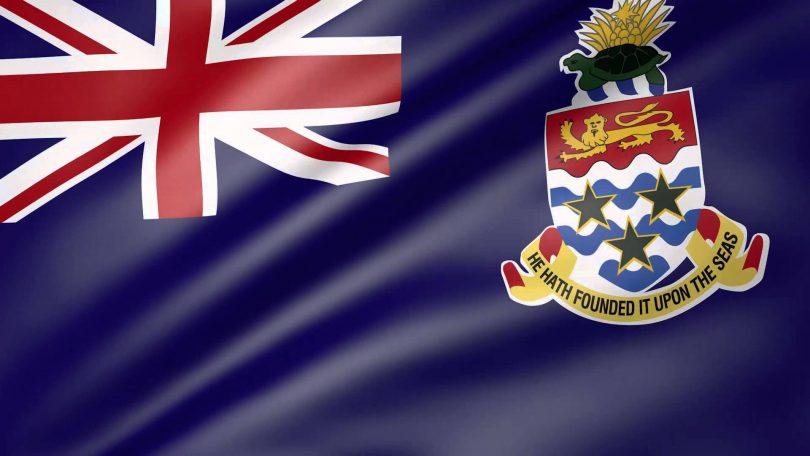 Lihlekehleke tsa Cayman: Tlhahiso ea semmuso ea COVID-19 ea Bohahlauli