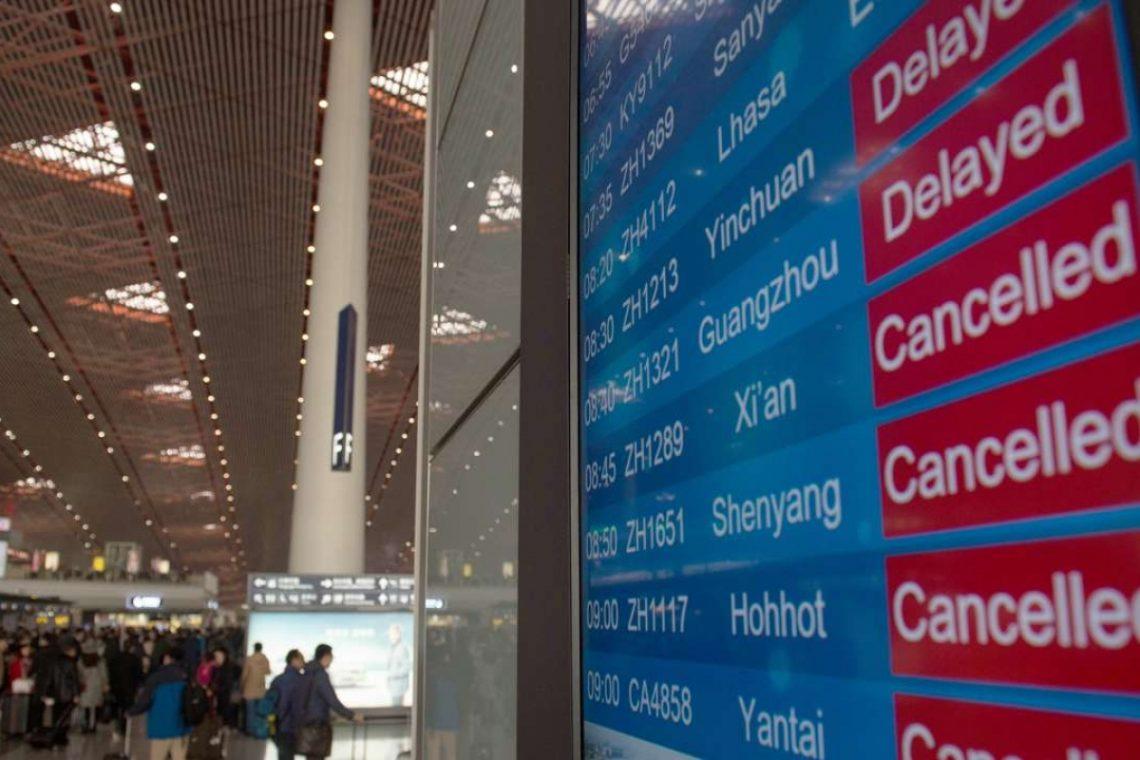 1,225 voos cancelados em Pequim hoje devido ao novo pico COVID-19