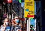 Amsterdam a Rotterdam erfuerderen elo Gesiichtsmasken a beschäftegte Stadstroossen