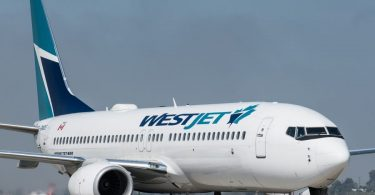 WestJet offers passengers free COVID-19 travel insurance
