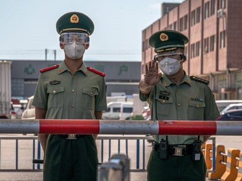 Beijing limits new daily arrivals to 500 people to curb COVID-19 spread