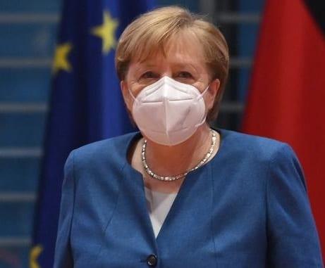 Germany extends lockdown, makes masks mandatory, warns of border closures