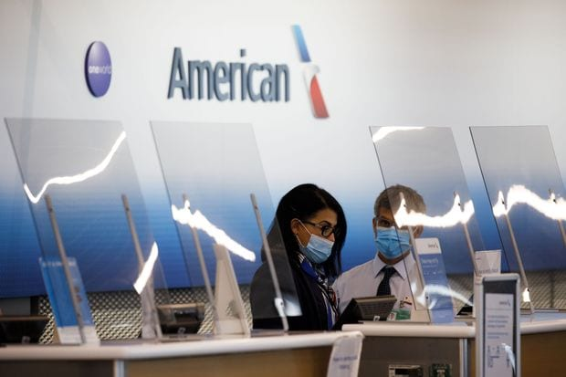 American Airlines to furlough 13,000 workers if planes remain grounded