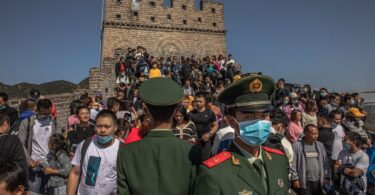 China rolls out strict anti-COVID measures at tourist sites ahead of holiday