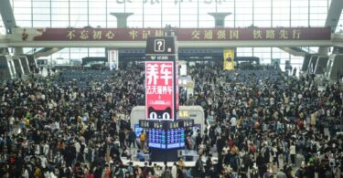 China's May Day holiday travel rush sets new records